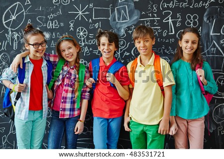 Schoolkids at blackboard