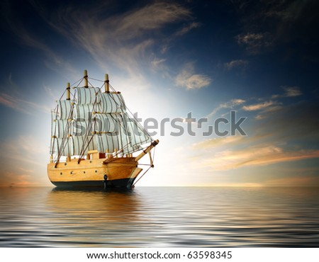 Schooner at sunset - stock photo