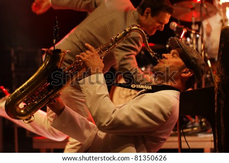 "SCHORNDORF - JULY 17: Group ""The CA$H"" in concert at SchoWO Schorndorf July 17, 2011 in Stuttgart, Germany - stock photo"