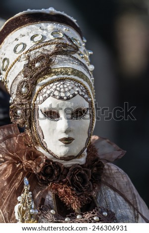 SCHWAEBISCH-HALL, GERMANY - February 23, 2014 - Person, dressed up in a Venetian style costume with plaster mask attends the Hallia Venetia Carnival festival on February 23, 2014 in Schwabisch-Hall. - stock photo