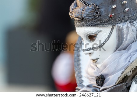 SCHWAEBISCH-HALL, GERMANY - February 23, 2014 - Woman, dressed up in a Venetian style costume with a white mask attends the Hallia Venetia Carnival festival on February 23, 2014 in Schwabisch-Hall. - stock photo