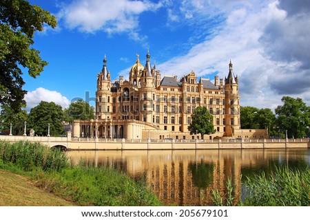 Schwerin Castle (Schweriner Schloss) reflected in the lake, Germany - stock photo