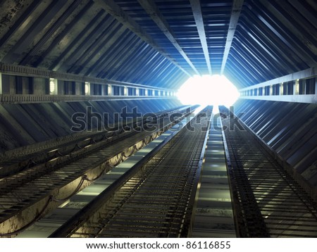 Sci-fi corridor leading to light - stock photo