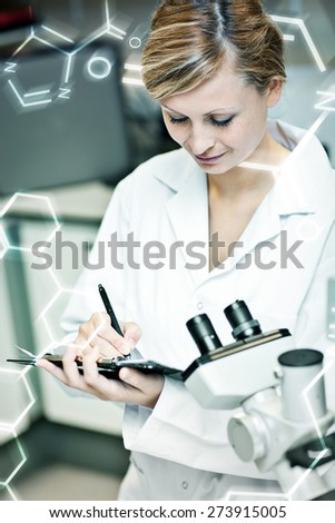 Science and medical graphic against concentrated female scientist writing on her clipboard