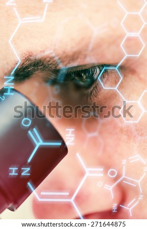 Science and medical graphic against extreme close up of a scientific researcher using microscope - stock photo