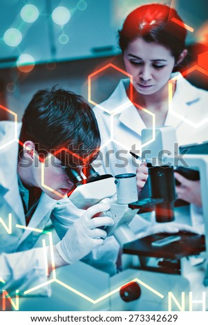 Science and medical graphic against portrait of a young scientist looking in a microscope while another is taking notes - stock photo