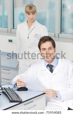 science and research biology chemistry and medicine  youn people couple in bright modern  lab - stock photo
