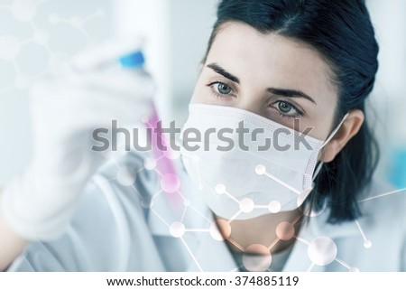 science, chemistry, biology, medicine and people concept - close up of young female scientist holding tube with sample making and test or research in clinical laboratory - stock photo