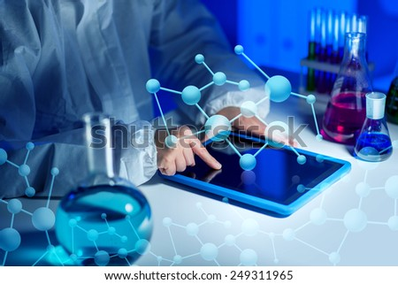 science, chemistry, medicine, technology and people concept - close up of young female scientist with tablet pc computer making test or research in laboratory - stock photo