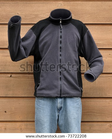 Science fiction photograph of an invisible man wearing a sweat shirt outside - stock photo