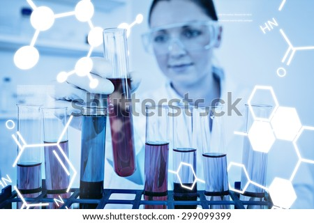 Science graphic against beautiful redhaired woman holding a test tube - stock photo
