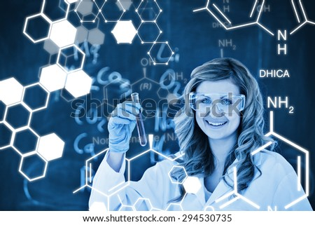Science graphic against blondhaired woman carrying out an experiment - stock photo