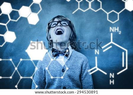 Science graphic against boy laughing in front of blackboard - stock photo
