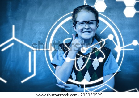 Science graphic against portrait of cute little girl gesturing thumbs up - stock photo