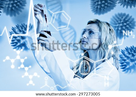 Science graphic against woman looking at beaker of red liquid - stock photo