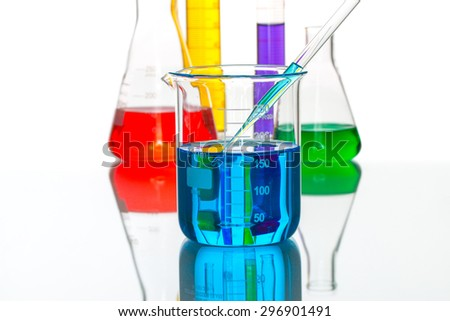 science Laboratory glassware pipette drop, reflective white background for chemical research - stock photo