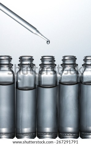 Science laboratory research, Dropping chemical liquid to test tubes, - stock photo