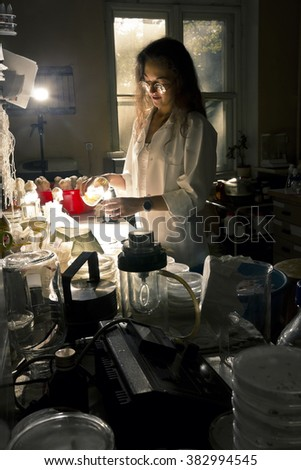 science professional is working in old laboratory - stock photo