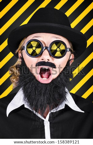 Science research geek wearing nuclear symbol on glasses expressing shock in an atomic discovery. Mad scientist concept