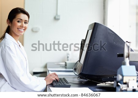 Science student with a monitor looking at the camera