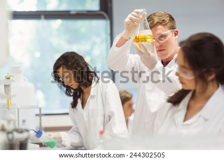 Science students working in the laboratory at the university - stock photo