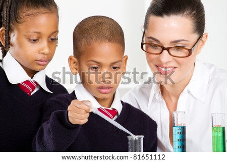 science teacher and students in lab - stock photo