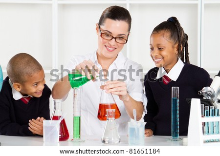 science teacher teaching students in lab - stock photo