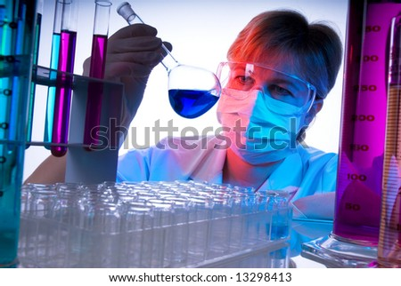 science technician at work in the laboratory - stock photo