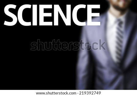 Science written on a board with a business man on background - stock photo