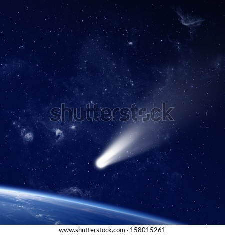 Scientific and astrological background - comet approaches planet earth, space with stars and nebula; mystical sign in sky. Elements of this image furnished by NASA - stock photo