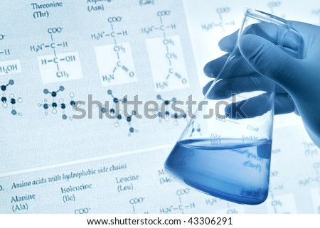 Scientific concept--Scientist holding conical flask with liquid over a scientific background. - stock photo