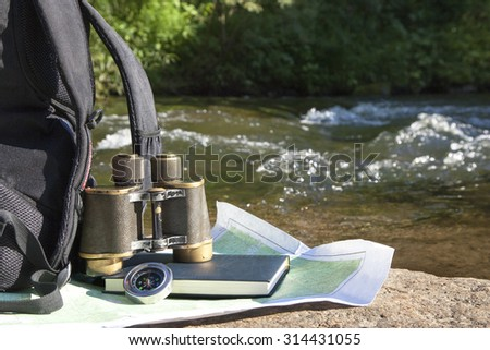 scientific expedition along the river on the rocks - stock photo
