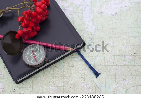 scientific expedition  on the map. compass. knife - stock photo