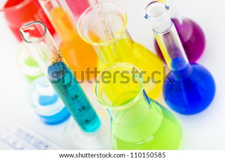 Scientific laboratory glassware filled with color liquid ready for chemical experiment in a science research lab - stock photo
