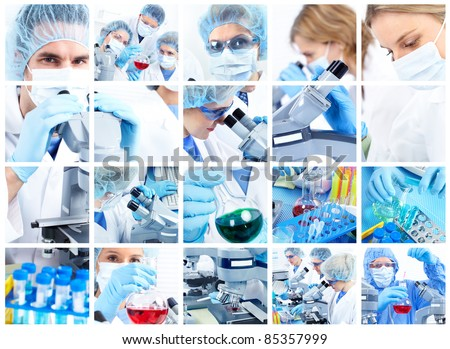 Scientific people working with a microscope in lab. - stock photo