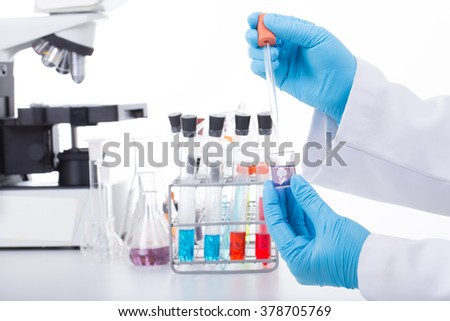 scientist.  Absorb chemicals from the bottle In the lab. For the experiments - stock photo