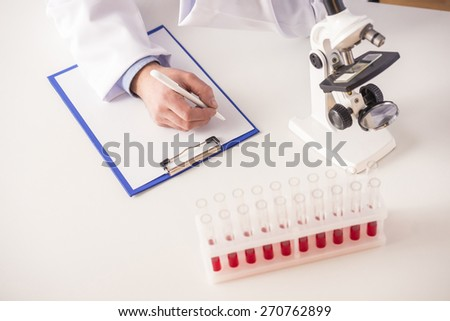 Scientist concept. Scientist working in laboratory with microscope. - stock photo