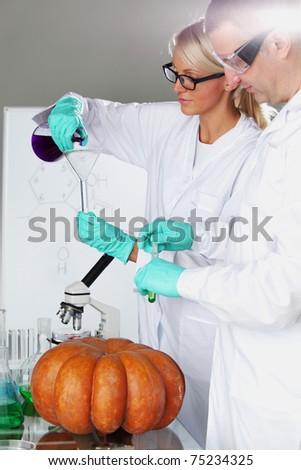 Scientist conducting genetic experiment - stock photo