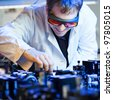 scientist doing research in a quantum optics  lab (shallow DOF; color toned image) - stock photo