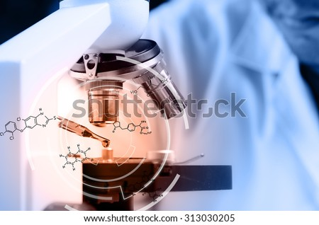 Scientist  dropping chemical liquid to microscope with chemical equations, Laboratory research concept - stock photo