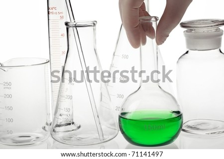 Scientist hand holding a flask in a research lab. - stock photo