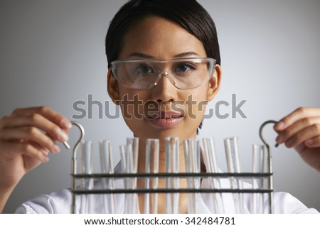 Scientist Holding Rack Of Test Tubes