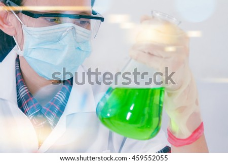 Scientist holding test tube or some equipment of science with hand in laboratory, film effect, copy space.