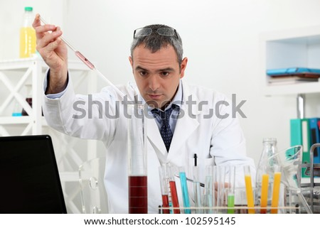 Scientist in a lab experiment - stock photo