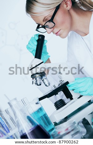 scientist in chemical lab conducting experiments - stock photo