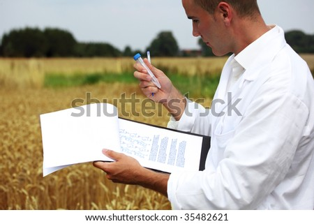 Scientist in the field collecting sample for analysis - stock photo
