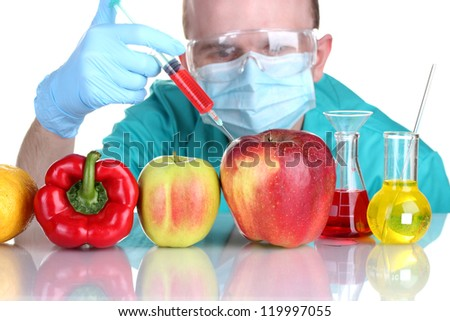 Scientist injecting GMO into the vegetables - stock photo