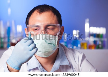 Scientist is thinking about research and hold eppendorf tube - stock photo
