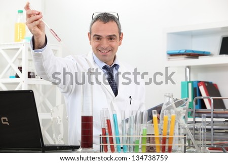 scientist making tests in the lab - stock photo