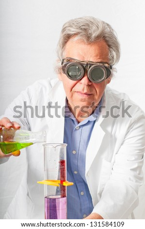 Scientist mixing up chemicals